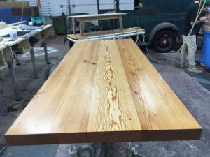 white pine floor joist table top with a clear finish